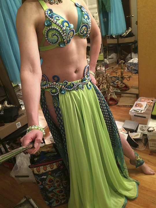 8) Trying my costume on. The skirt I made is actually the underskirt for this costume. I got several compliments on the burst of pattern that people would see on the underskirt as a moved about.
